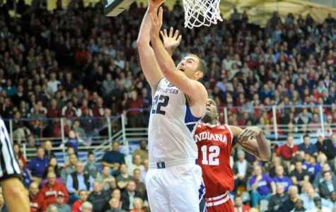 Alex Olah goes in for the layup. The junior center recorded his 137th career block on Wednesday, breaking John Shurna's all-time Northwestern record in the category.