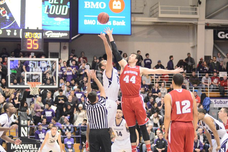 Frank Kaminsky reaches for the opening tip against Northwestern's Alex Olah. The Wildcats will likely need to quell the 7-foot senior forward who averages 17.8 points and 8.1 rebounds per game and has emerged as one of college basketball's top players in order to have any shot at victory.