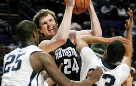 John Shurna battles his way through two defenders. The former Northwestern standout was instrumental in the Wildcats' failed attempt at an NCAA Tournament bid in the 2011-2012 season.