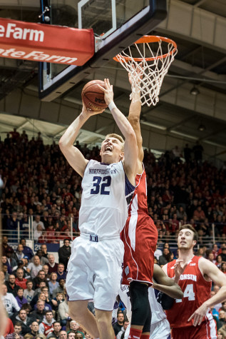 Men's Basketball: Wildcats pull off thrilling upset of Hawkeyes for second Big Ten win