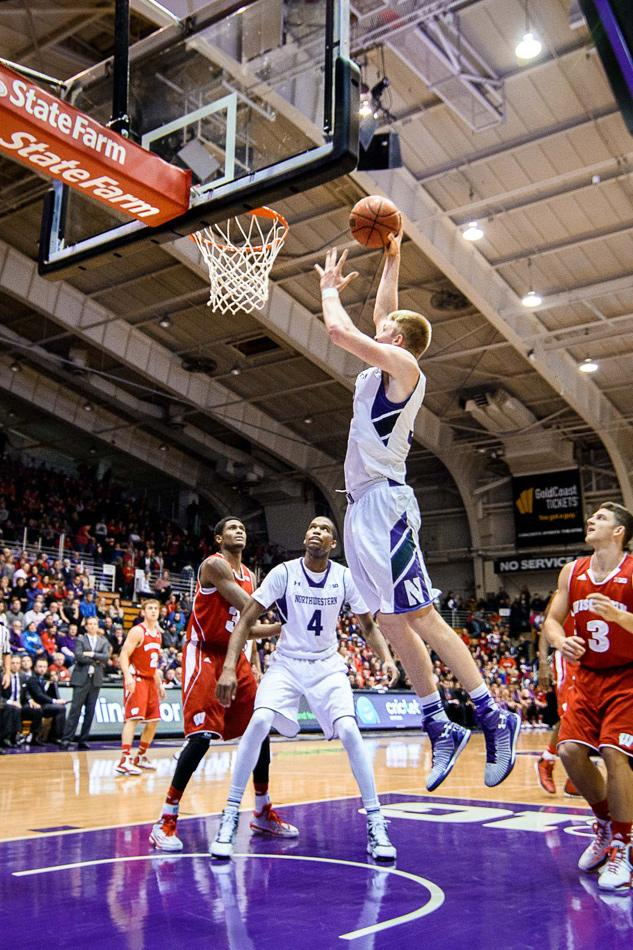 Nathan Taphorn goes up for a layup. The impactful sophomore forward has been sidelined with a stress injury in his foot for most of Northwestern's losing streak.