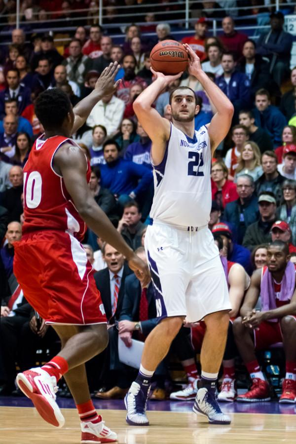 Alex+Olah+pulls+up+for+the+3-pointer.+The+junior+center+posted+a+double-double+in+Northwestern%E2%80%99s+66-61+overtime+win+against+Iowa+and+could+be+a+key+figure+in+deciding+whether+the+Wildcats+reach+or+eclipse+four+conference+wins.