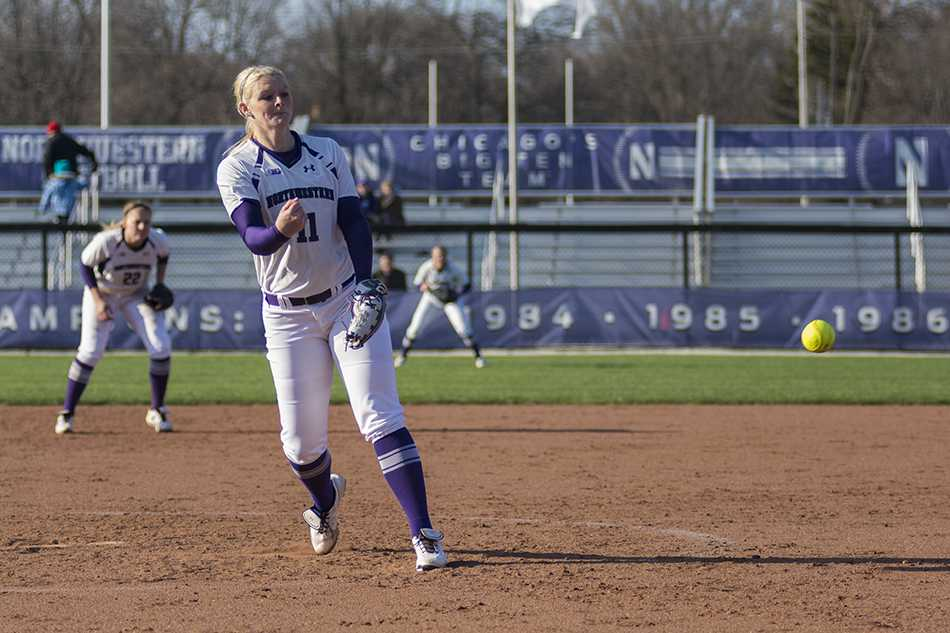 Kristen Wood releases a pitch toward the plate. The junior pitcher was a bright spot for Northwestern over the weekend, taking two no-hitters into the fifth inning.