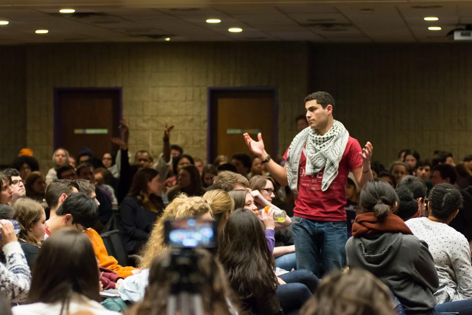 Off-campus senator Marcel Hanna, a Weinberg sophomore, speaks during Associated Student Government's marathon debate on the Northwestern Divest-sponsored resolution Wednesday night. The resolution passed with 24 votes for, 22 against and three abstentions.