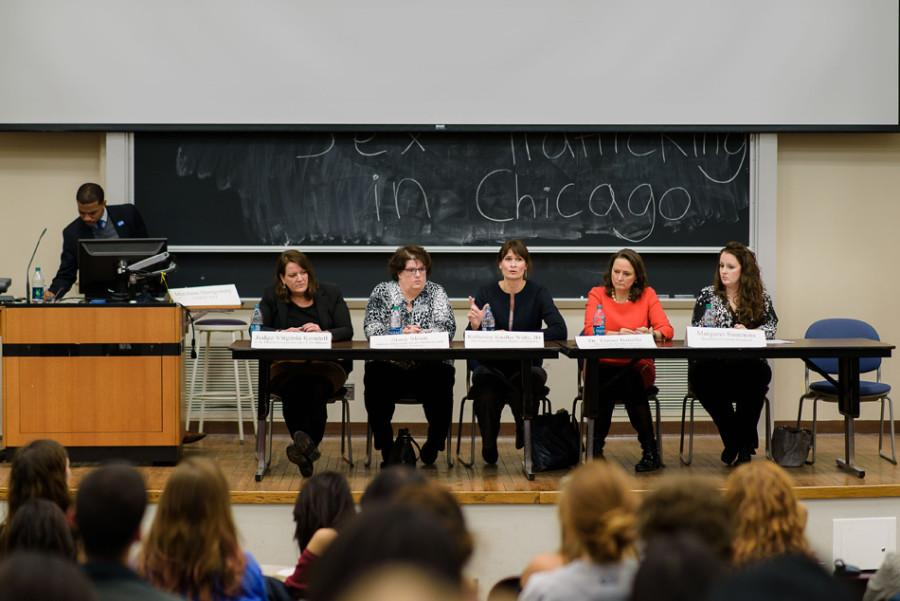 Five panelists discuss human trafficking in Fisk 217 on Wednesday. The panel examined trafficking on an international scale before zooming in on Chicago's struggles with the issue.