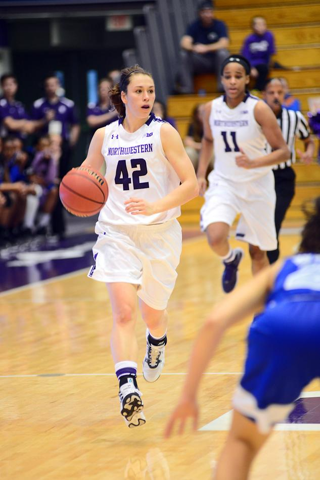 Guard Karly Roser dribbles up the court. The senior started Sunday's game against Illinois and helped Northwestern overcome the Fighting Illini after sophomore Christen Inman was a late scratch.