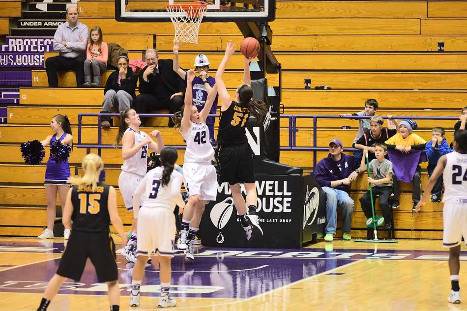 Karly Roser contests the shot. The senior guard has earned a starting role in sophomore guard Christen Inman's absence and has done an admirable job as a fill-in.