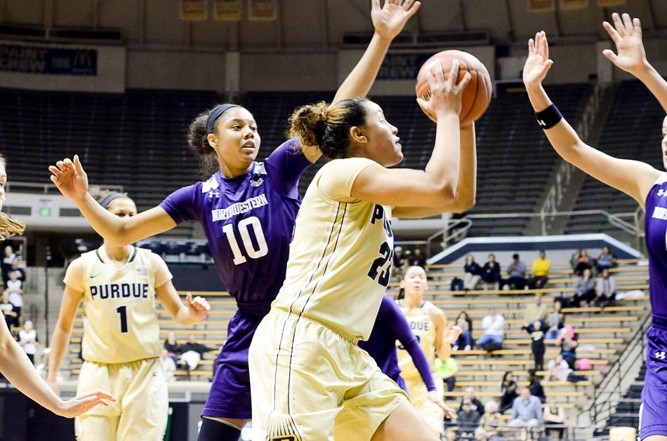 Nia Coffey moves into position. The sophomore forward did not miss from the free throw line on Wednesday night and settled into a key 17-point, 11-rebound performance in a Wildcats win.