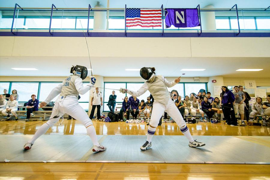 Stella Pointeau (right) lands a strike on an opponent. The freshman foil was undefeated in her first six matches of the season.