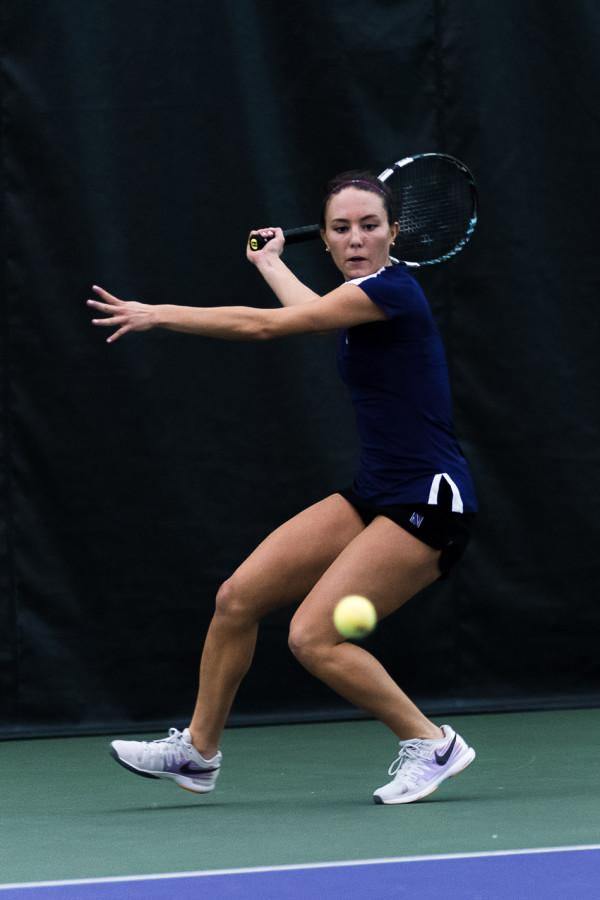Manon Peri winds up for a forehand. The sophomore is still out for the time being, one of the three injuries that is forcing the Wildcats to use the most out of every healthy player on the roster.
