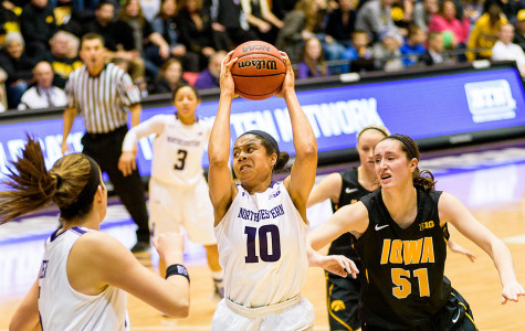 Nia Coffey navigates her way past an Iowa defender. The sophomore forward's strong play has helped Northwestern achieve its first ranking in the AP poll in 19 years.