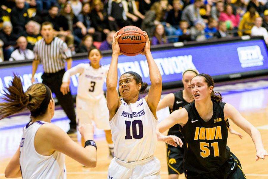 Nia+Coffey+navigates+her+way+past+an+Iowa+defender.+The+sophomore+forward%E2%80%99s+strong+play+has+helped+Northwestern+achieve+its+first+ranking+in+the+AP+poll+in+19+years.