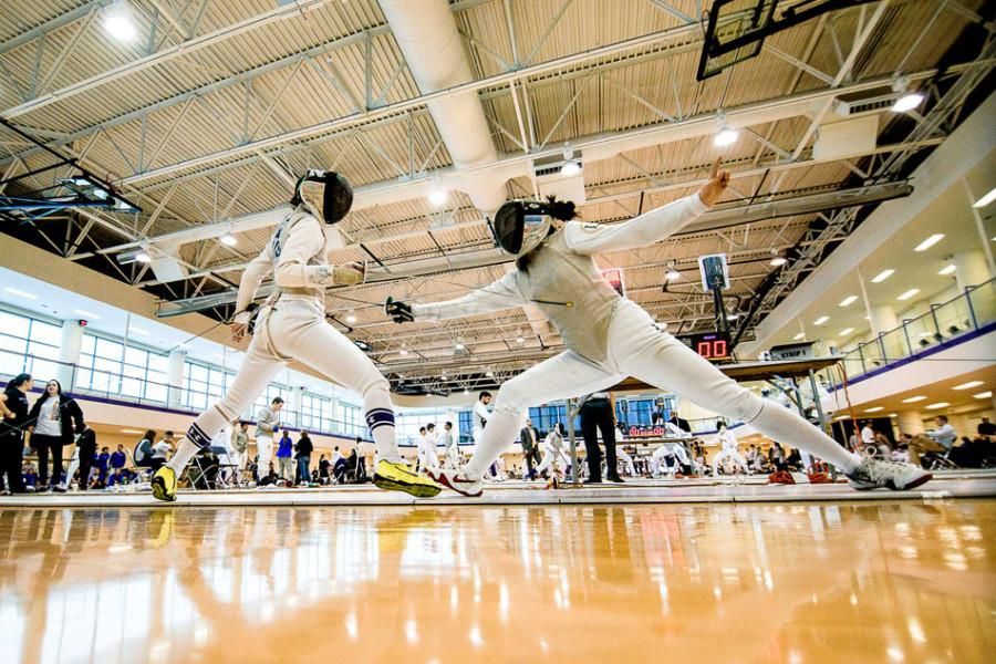 A Northwestern fencer, left, dodges a thrust from an opponent. The Wildcats had a strong performance this weekend but ultimately came up short against rival Ohio State.