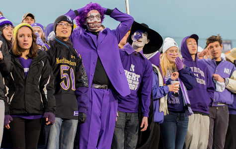 Medill junior Michael Payant (center) attends nearly every Northwestern football or men's basketball game — often decked out in face paint and a purple costume — and encourages other students to do the same.