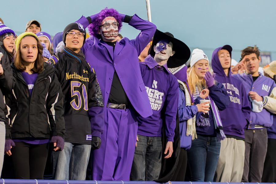 """Medill junior Michael Payant (center) attends nearly every Northwestern football or mens basketball game — often decked out in face paint and a purple costume — and encourages other students to do the same. It takes so little to hop on the shuttle and walk down to the game,"""" he said."""