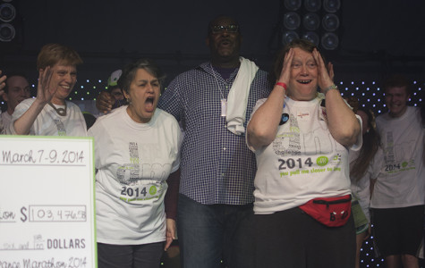 Evanston Community Foundation President Sara Schastok (right) reacts to receiving a check from Dance Marathon for $103,476.58 in 2014. DM 2015 will be Schastok's last year as CEO and president of DM's secondary beneficiary.