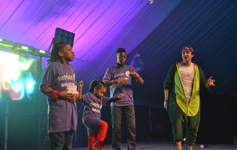 Tennille Palms' children, including 11-year-old Jahrel, dance on stage during Block 3. The family is part of the Heroes Program and shared stories of Starlight Children's Foundation's impact.