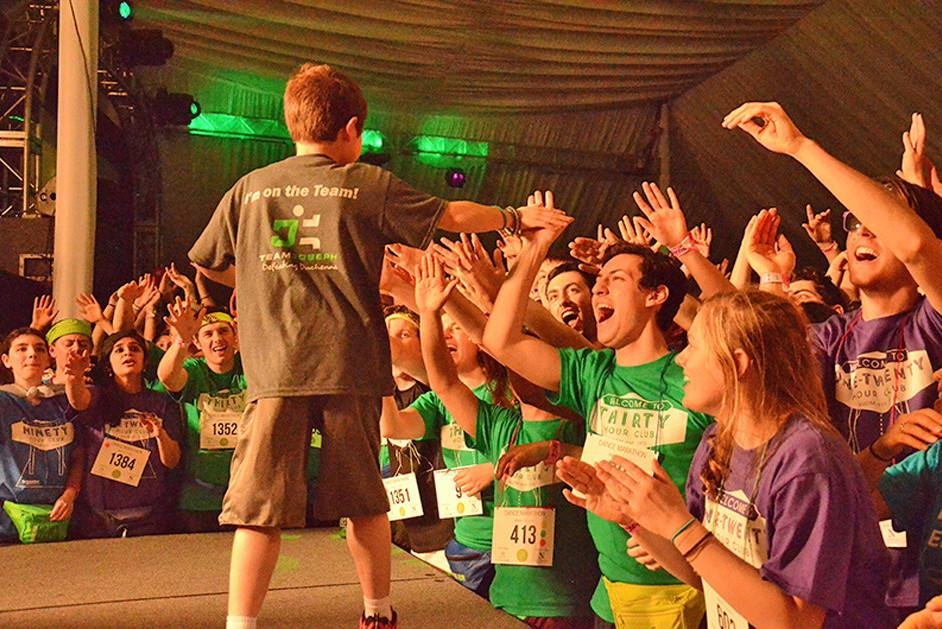 Students celebrate during Dance Marathon 2014. After a letter to the editor was published in The Daily in April 2014 criticizing a lack of inclusivity in DM, the organization has implemented new initiatives, like gender-open changing rooms.