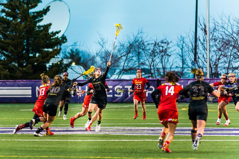 Junior midfielder Lauren Murray attempts to control a draw. Northwestern won two of three games over Spring Break despite struggling in the circle.