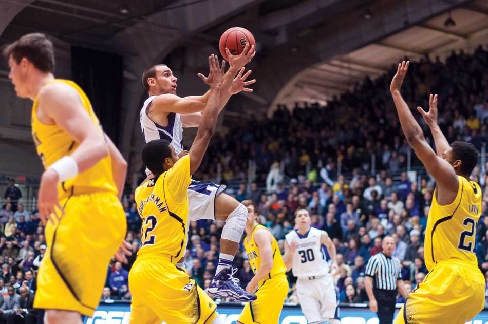 Tre Demps skies toward the basket. The junior guard saved Northwestern on Tuesday night, nailing a game-tying 3 near the end of regulation and in the final seconds of the first overtime to keep the Wildcats alive in an eventual 82-78 double-overtime victory.