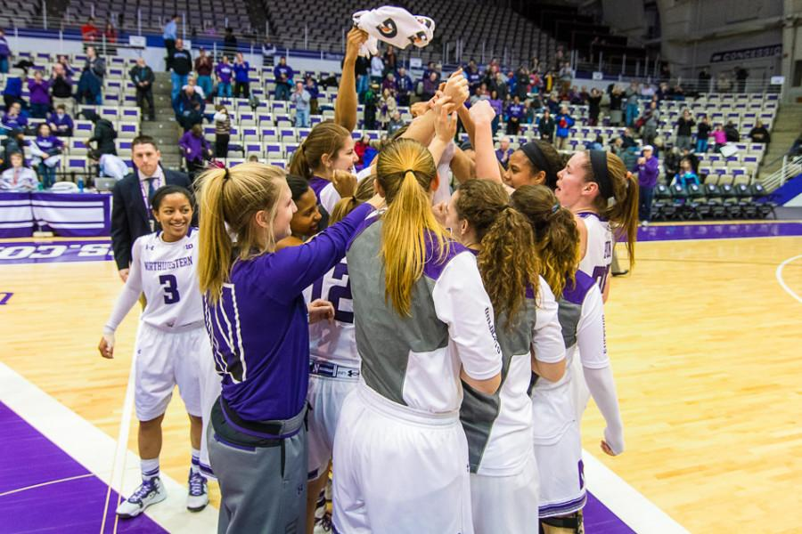 Northwestern huddles and celebrates a fine result. The Wildcats focused on team chemistry in the offseason and have parlayed that effort into a No. 4 seed in the Big Ten Tournament and a virtually guaranteed bid for the NCAA tournament.