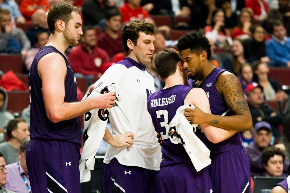 Guard Dave Sobolewski embraces guard JerShon Cobb. The seniors played their final career games in Northwestern's 71-56 Big Ten Tournament loss to Indiana.