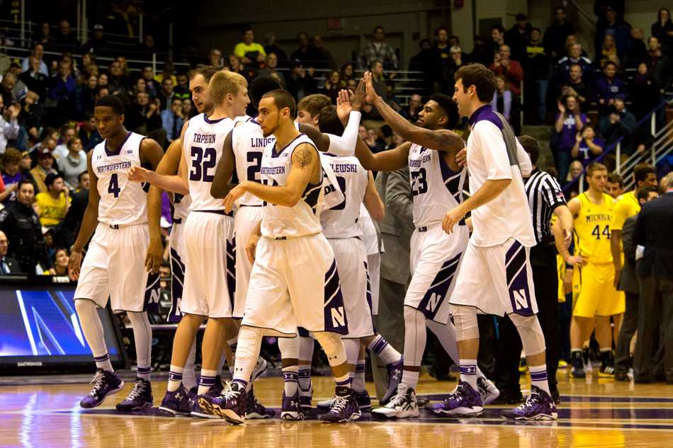 JerShon Cobb (23) celebrates with his teammates. The senior guard surprised his coach with 14 points and eight rebounds in the final game of his career at Welsh-Ryan Arena.