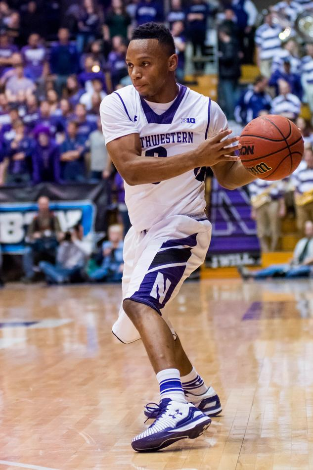 Johnnie Vassar sets up for a pass. The freshman guard has decided to transfer, coach Chris Collins said Monday.
