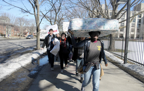 Students carry mattresses and pillows to the Rebecca Crown Center on Monday morning to protest a Northwestern professor's opinion piece on relationships between professors and students. About 30 students marched and posted signs at the Crown Center.