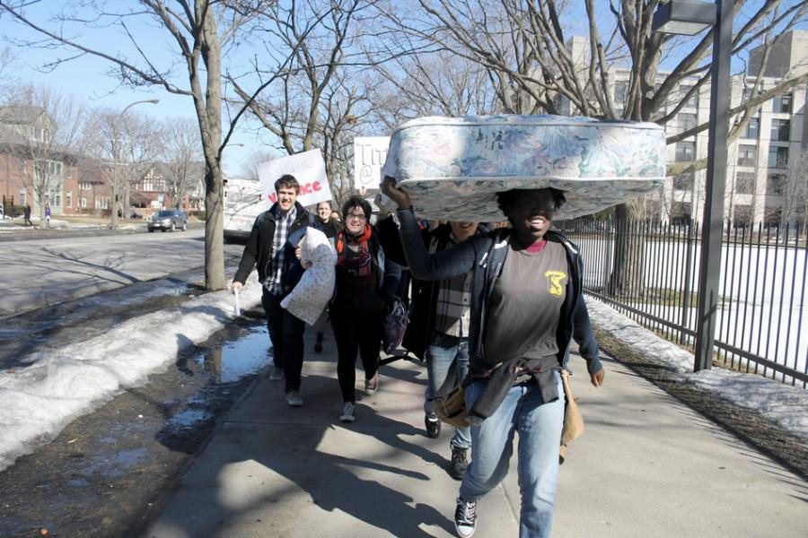 Students+carry+mattresses+and+pillows+to+the+Rebecca+Crown+Center+on+Monday+morning+to+protest+a+Northwestern+professor%27s+opinion+piece+on+relationships+between+professors+and+students.+About+30+students+marched+and+posted+signs+at+the+Crown+Center.