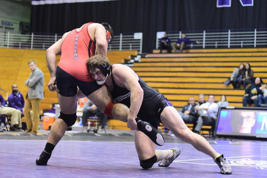 Mike McMullan battles Wisconsin's Connor Medbery. The senior heavyweight captured his first Big Ten title Sunday by defeating rival Bobby Telford in the finals.
