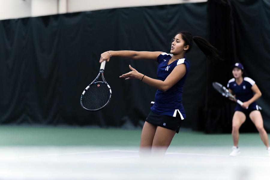 Rheeya Doshi completes a stroke. The freshman returned from injury and saw her first singles action of the season on Sunday against Texas.