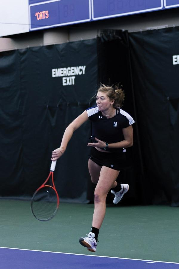 Alicia Barnett follows through on a serve. The junior is the team's No. 1 in singles, and has won three of her last four matches from the spot.