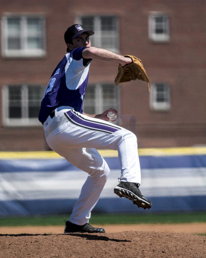 Reed Mason winds up for a pitch. The junior pitcher's relief appearance was instrumental in helping Northwestern scrape out an extra-inning victory over the weekend.