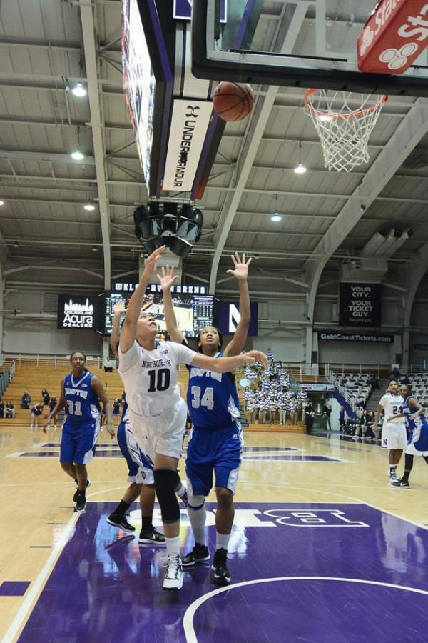 Nia Coffey hoists up a shot. The sophomore forward missed a potential go-ahead jumper in the final seconds and followed it up with a turnover that essentially sealed Northwestern's defeat on Friday.