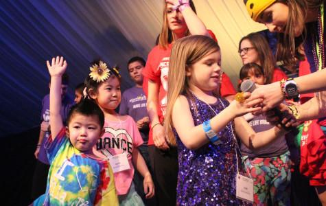 A group of Dance Marathon heroes join students on stage, grooving out during Block 9 to a sea of adoring dancers. As a full day passed, the tent began to liven up with only a few hours left in DM.
