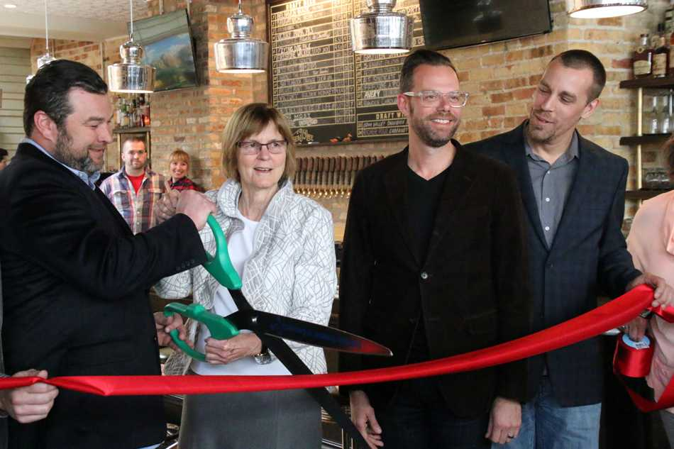 Mayor Elizabeth Tisdahl and members from Footman Hospitality cut the ribbon at Bangers & Lace's grand opening. The bar officially opened in the space formerly occupied by The Keg of Evanston in December but held off on holding a ceremony until this spring.