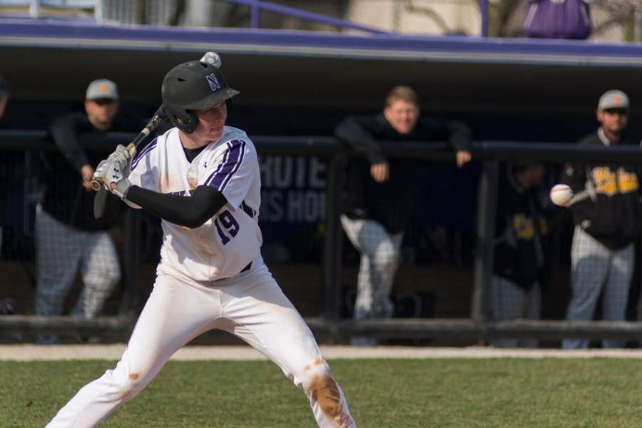 Sophomore outfielder Matt Hopfner takes a pitch. Timely hitting was the difference for Northwestern in avoiding being swept by Iowa in the final game of the series.