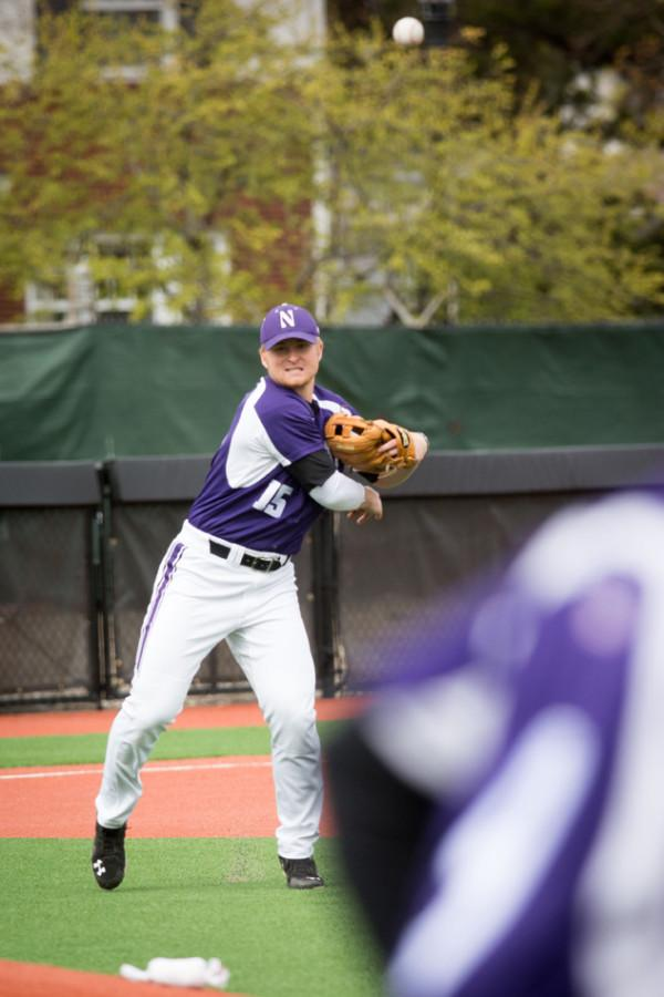 Connor Lind makes a throw. The freshman third baseman excelled at the plate Wednesday, notching two hits and scoring a run.