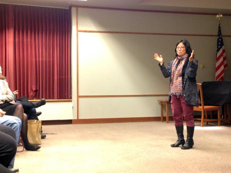 """Grace Lee addresses an audience of about 25 following a screening of her documentary """"American Revolutionary: The Evolution of Grace Lee Boggs"""" at Evanston Public Library on Thursday. The documentary focuses on the life and work of Chinese-American civil rights activist Grace Lee Boggs."""