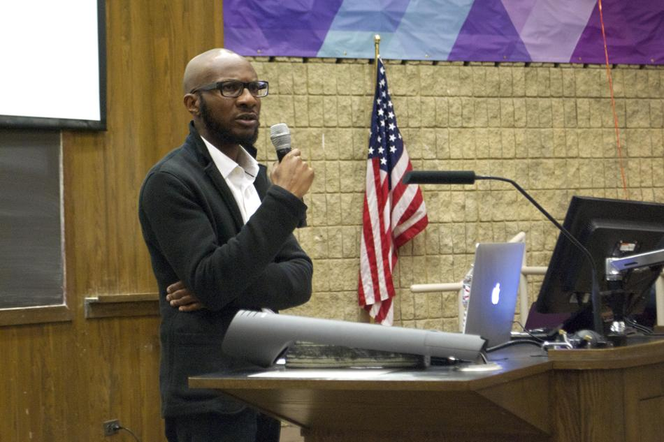 """Novelist Teju Cole discusses the """"white-savior industrial complex"""" Thursday night. Cole, author of the novel """"Open City,"""" said he was surprised so many people attended the event."""