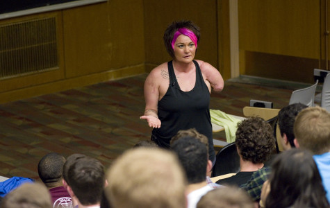 Sarah Panzau-Evans speaks to students at the Technological Institute on Thursday. Panzau-Evans, who lost most of her left arm in a drunk driving accident, urged students to make good decisions concerning drunken driving and to look out for their peers.