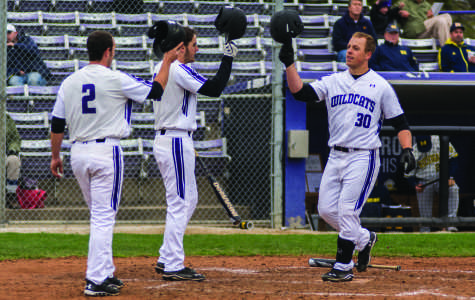 Joe Hoscheit celebrates a run with his teammates. The sophomore's clutch hitting helped Northwestern rally to its only win of the three-game weekend.