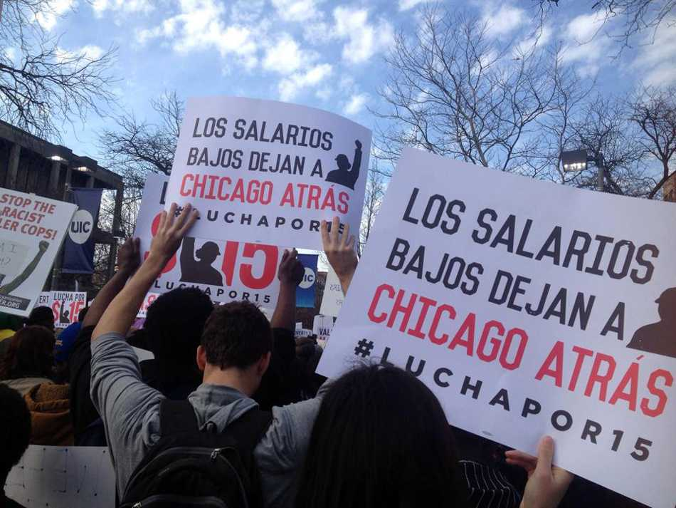 Students protest alongside Chicago workers and activists Wednesday. Around 30 Northwestern students joined the demonstrations, which were part of the national Fight for $15 campaign to raise the federal minimum wage from $7.25 to $15 an hour.