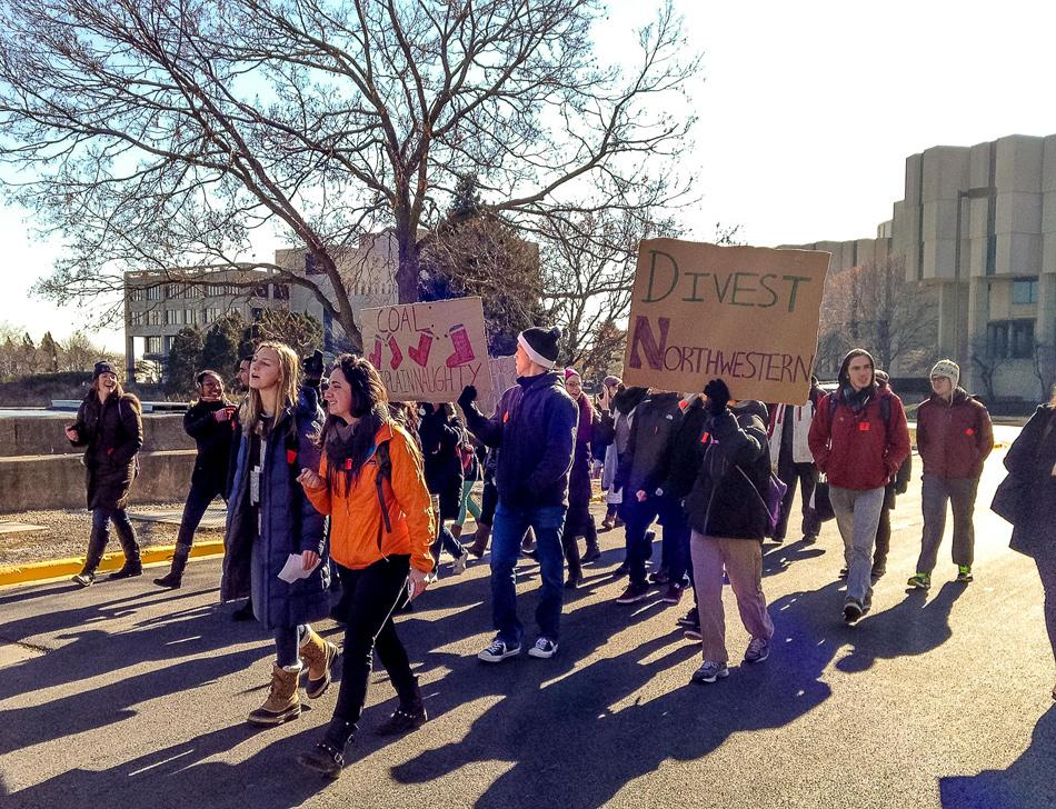 Students march to a Board of Trustees meeting in November to ask Northwestern to divest its endowment funds from the coal industry. Students can voice their opinions on coal divestment through an ASG referendum in this year's elections.