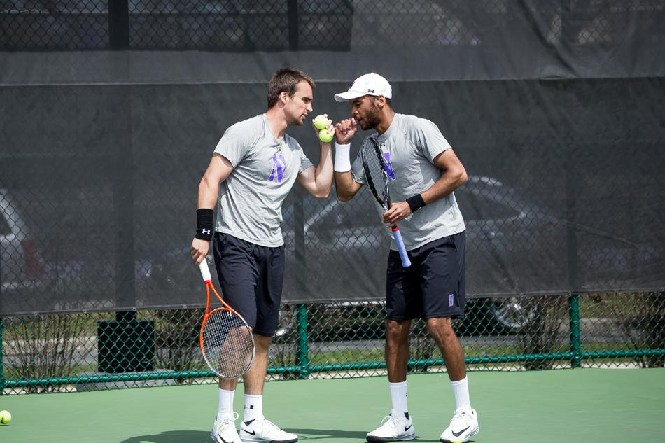Sophomore Sam Shropshire and senior Alex Pasareanu celebrate a point. The No. 44 doubles pair helped Northwestern to victory over Iowa on Sunday.