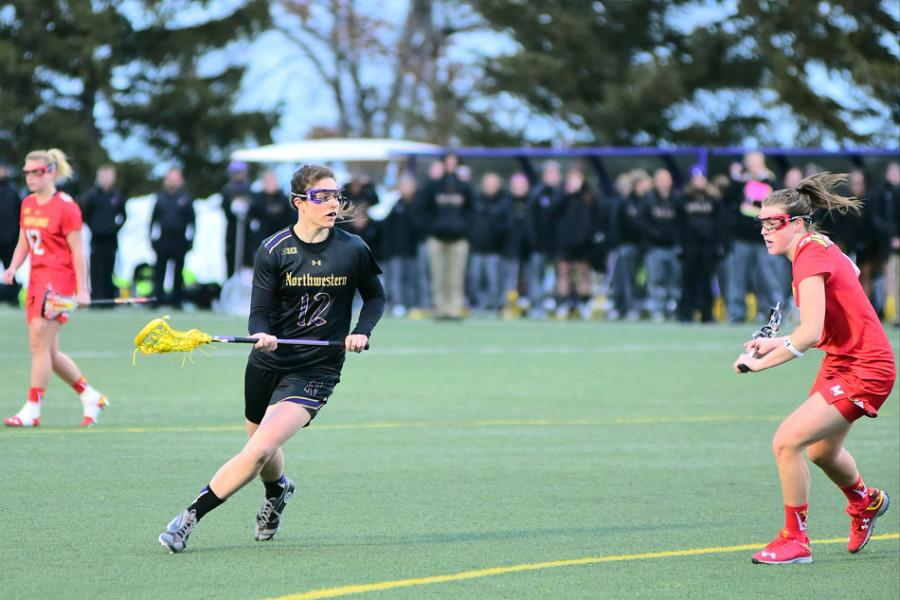 Kaleigh+Craig+probes+around+a+defender.+The+junior+scored+3+times+to+help+Northwestern+reach+its+highest+goal+total+of+the+season.