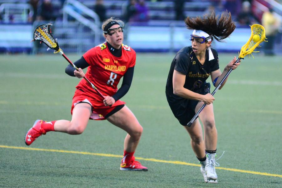 Attacker+Kara+Mupo+evades+a+Maryland+defender.+Sunday+the+fifth-year+senior+returns+to+Long+Island%2C+near+where+she+grew+up%2C+to+face+her+high+school+lacrosse+coach%2C+now+the+head+coach+at+Stony+Brook.