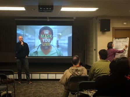 """Daniel Ruen, the pastor at Grace Lutheran Church of Evanston, introduces """"The Mask You Live In,"""" a documentary that discusses masculinity and gender stereotypes in America. The church hosted a screening of the film Saturday followed by a community discussion."""