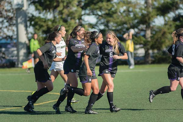 Nandi Mehta celebrates a goal with her teammates. The junior has an active role in student-athlete advocacy at Northwestern and at the conference and NCAA levels.